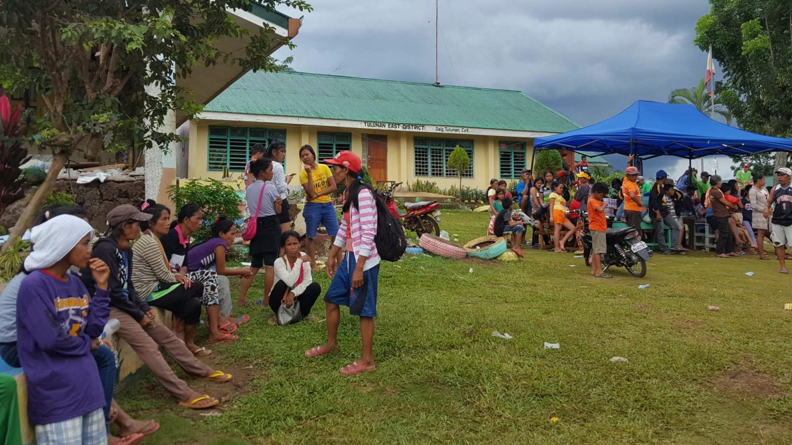 Filipinos-wait-outside-under-tents-and-trees-for-support-after-multiple-earthquakes-struck-the-Philippines-in-October