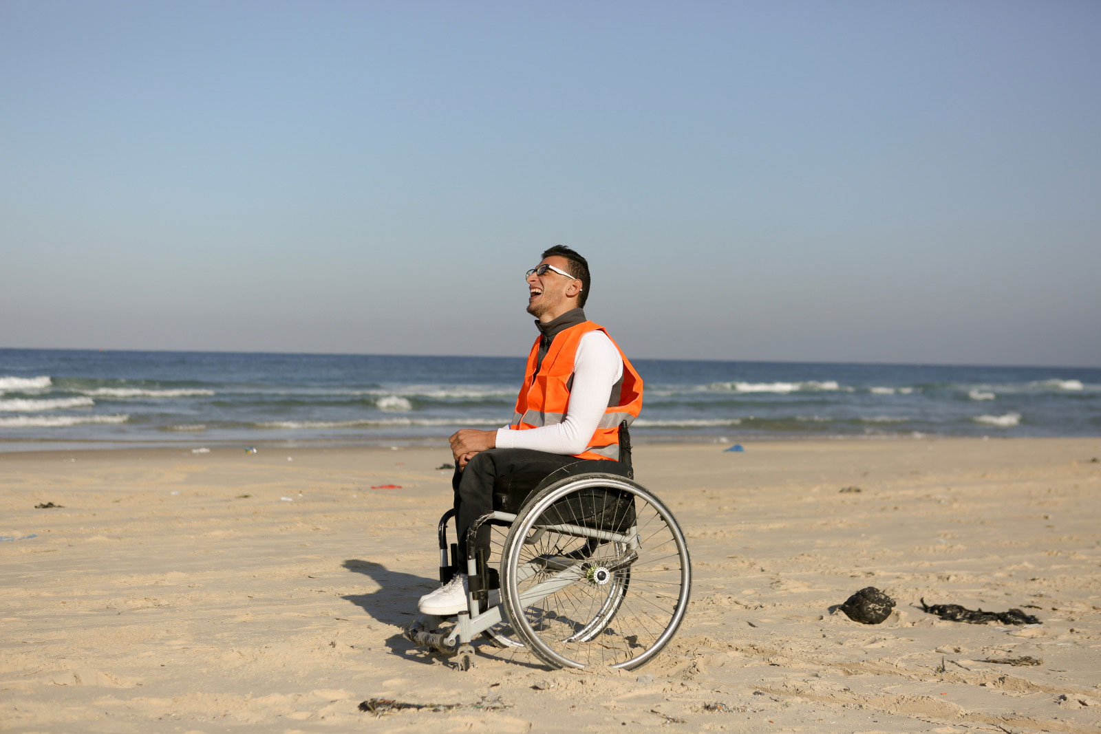 c_O-van-den-Broeck_HI__Ali_-who-enjoys-the-new-inclusive-beach-in-Gaza_-smiles-while-in-his-wheelchair-on-the-sand.jpg