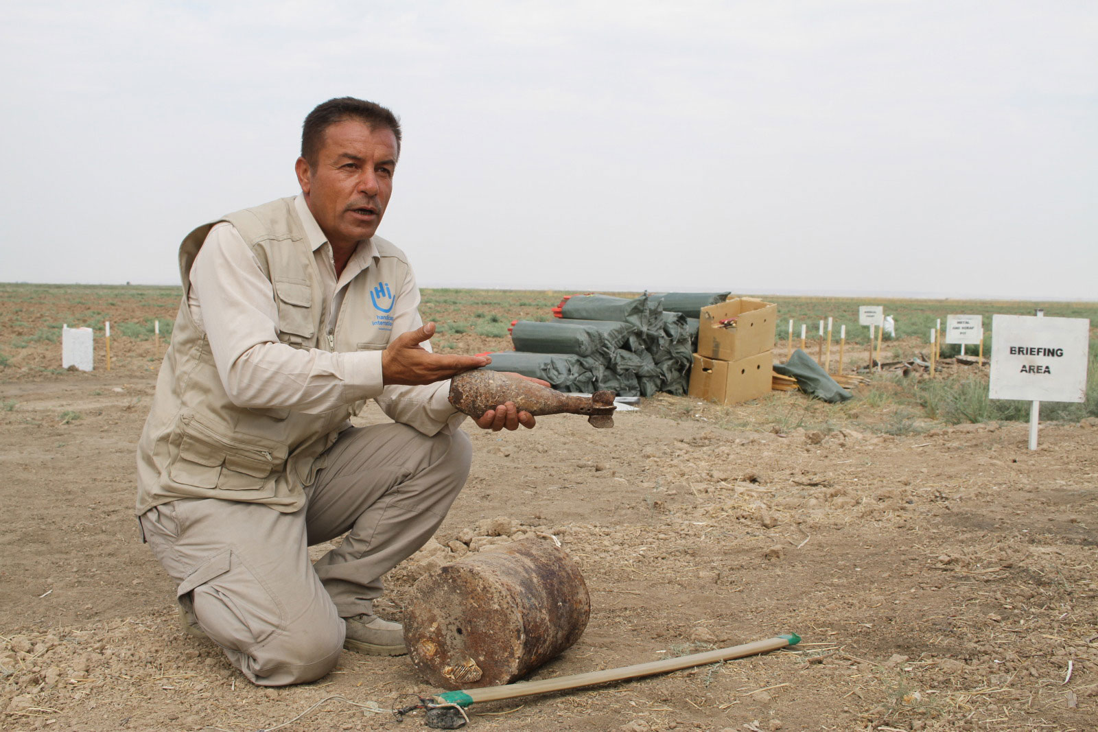 c_Shwan-Nawzad_HI__Hywa_-head-of-HI's-demining-team-in-Chad_-holds-an-explosive-remnant-of-war-in-his-hand.jpg