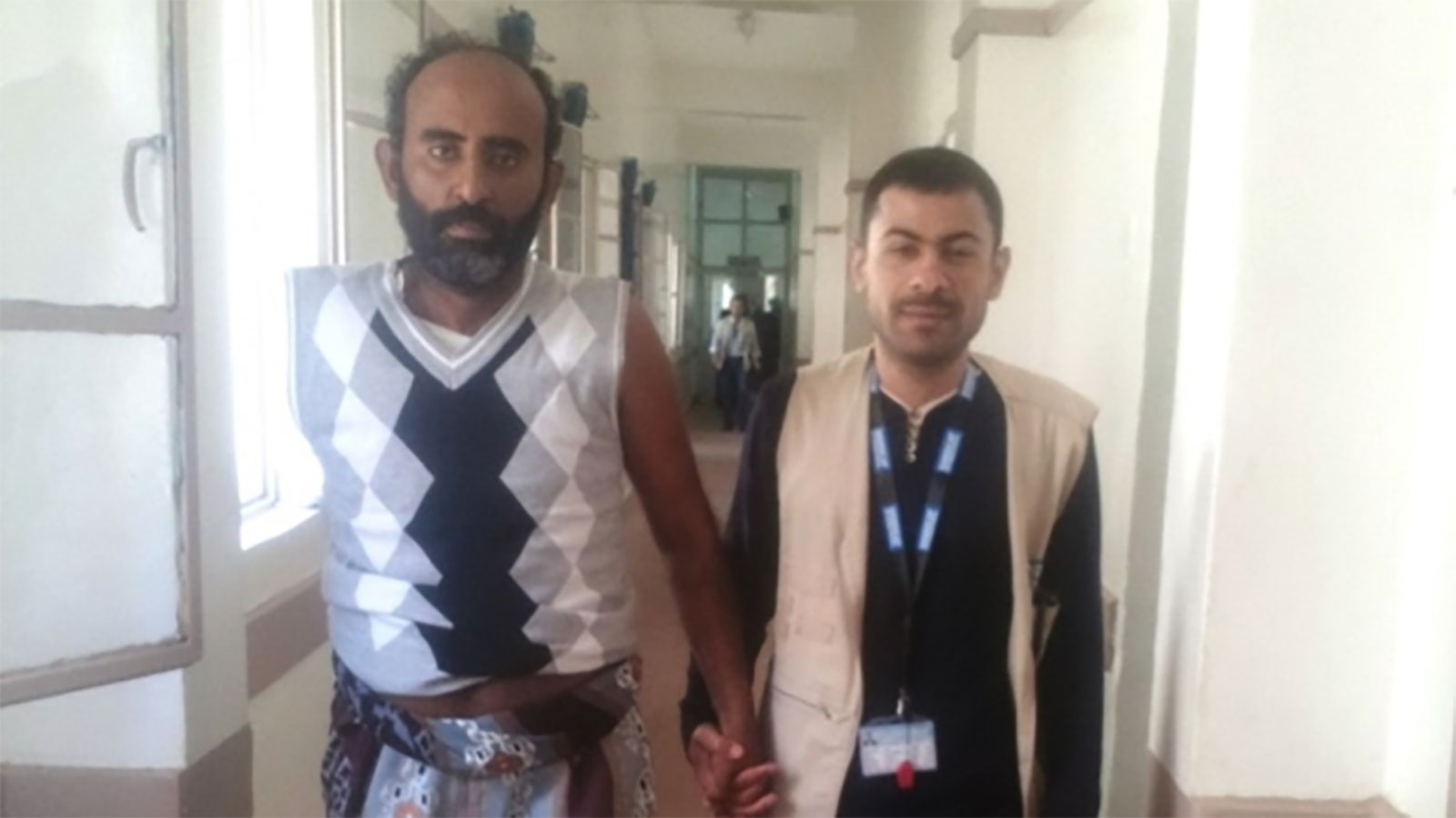 Abdulrahmam -who-was-injured-in-a-bombing-in-Yemen -walks-down-the-hall-of-a-hospital-with-support-from-an-HI-physical-therapist