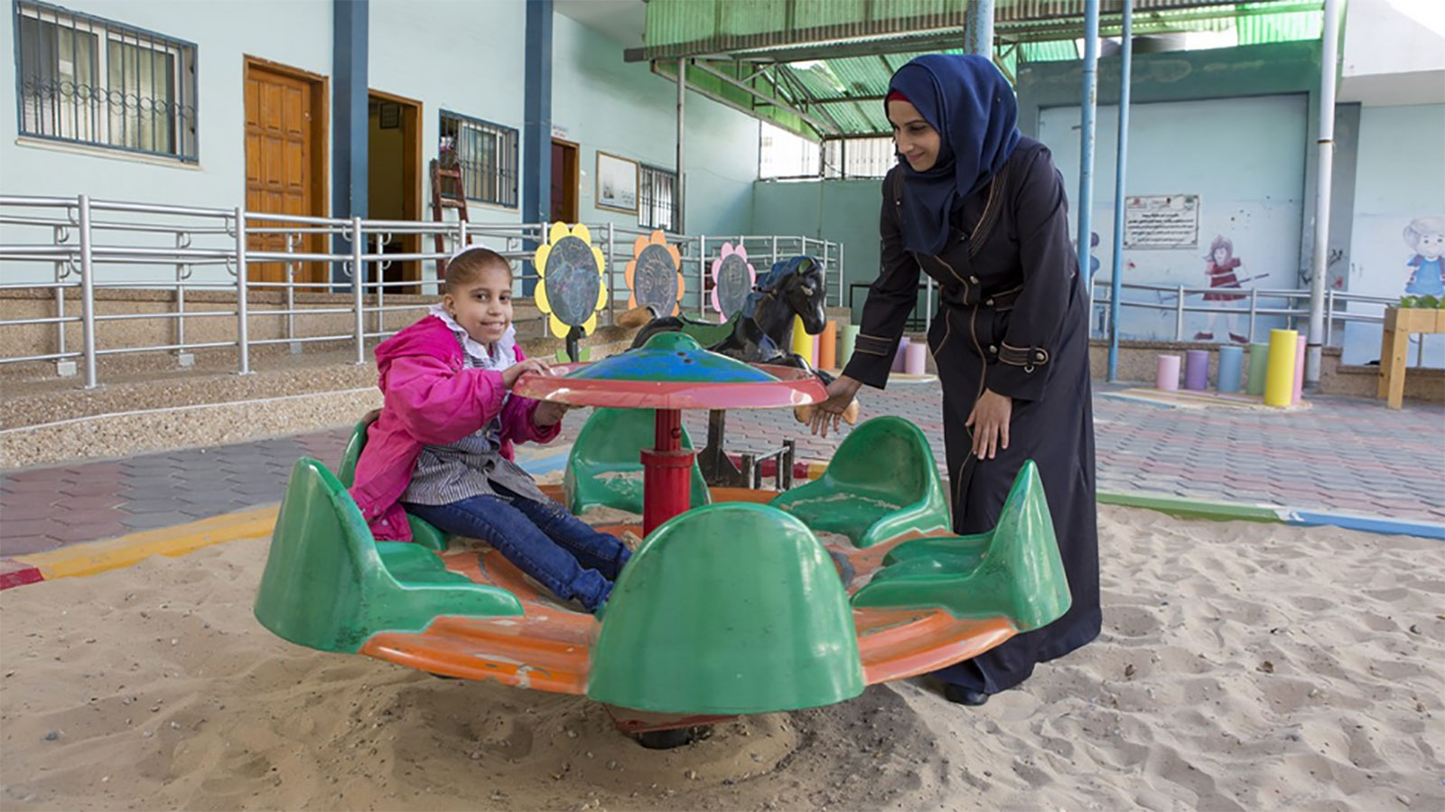 Narmeed-and-her-daughter-Shahed-play-outside-her-school