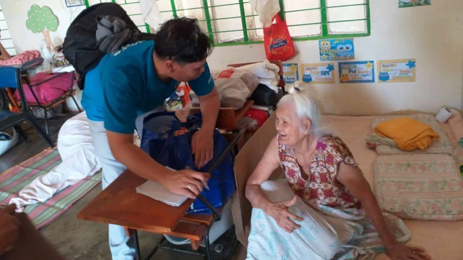 A-Humanity- -Inclusion-staff-member-assesses-the-needs-of-an-older-woman-in-the-Philippines-following-the-Jan-12-volcano