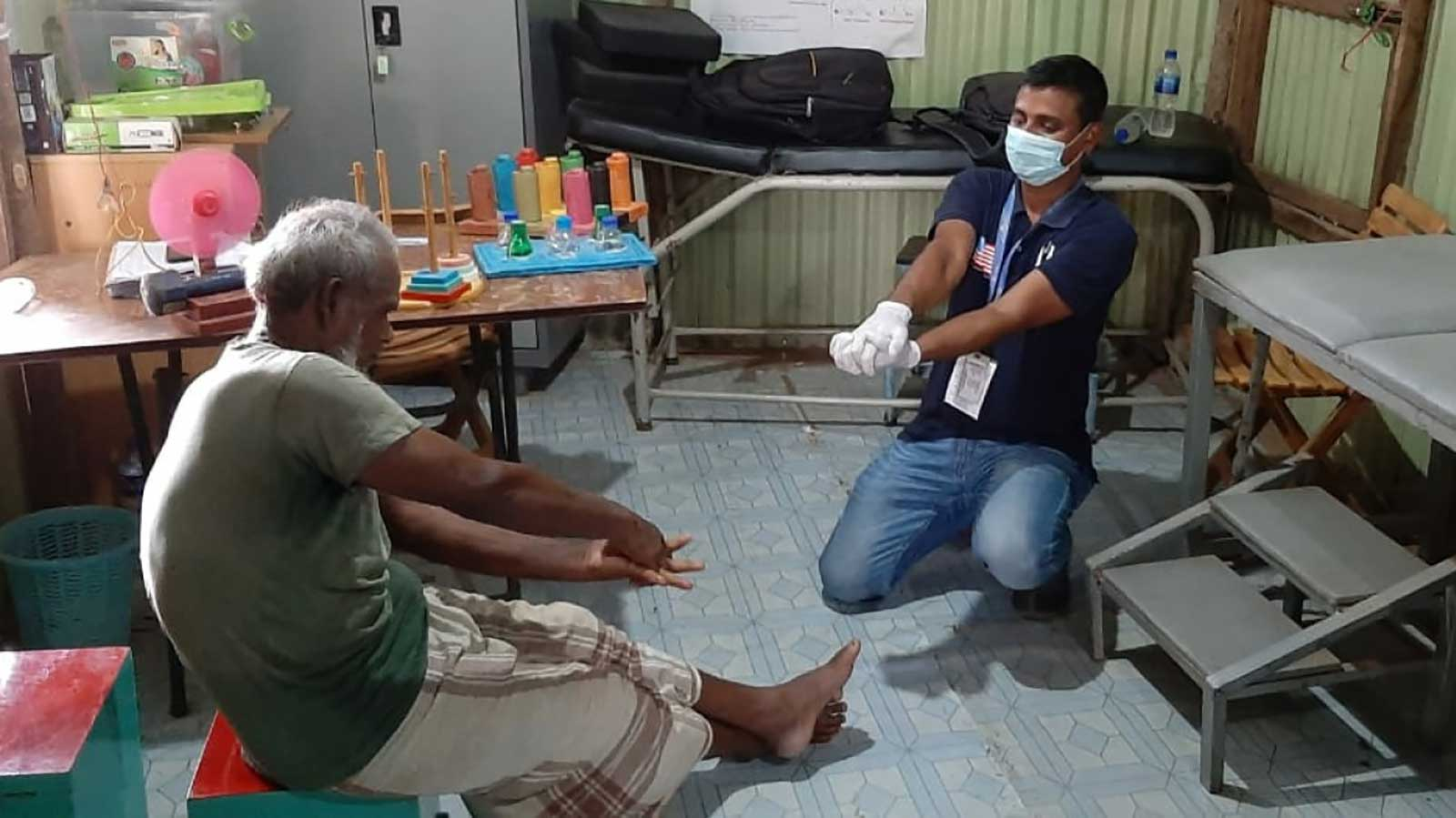 A-physical-therapist-with-HI-in-Bangladesh-does-rehabilitation-exercises-with-a-beneficary