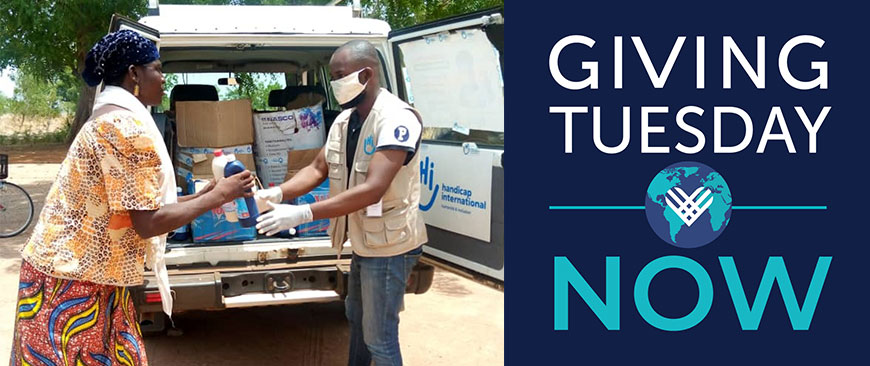 A Humanity & Inclusion staff member hands out hygiene kits to vulnerable individuals in Togo.