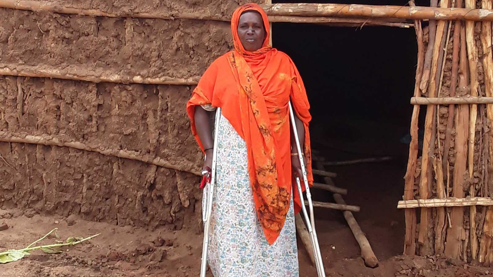 Meryam -40-year-old-mother-of-10 stands tall on her crutches in Ethiopia