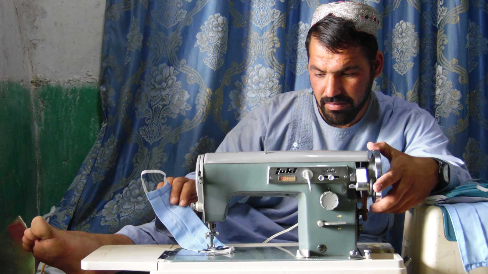 COVID-19 in Afghanistan | Father with disability makes life-saving masks