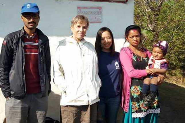 c_HI__Humanity-_-Inclusion's-Smirti-with-a-beneficary-who-has-clubfoot.jpg