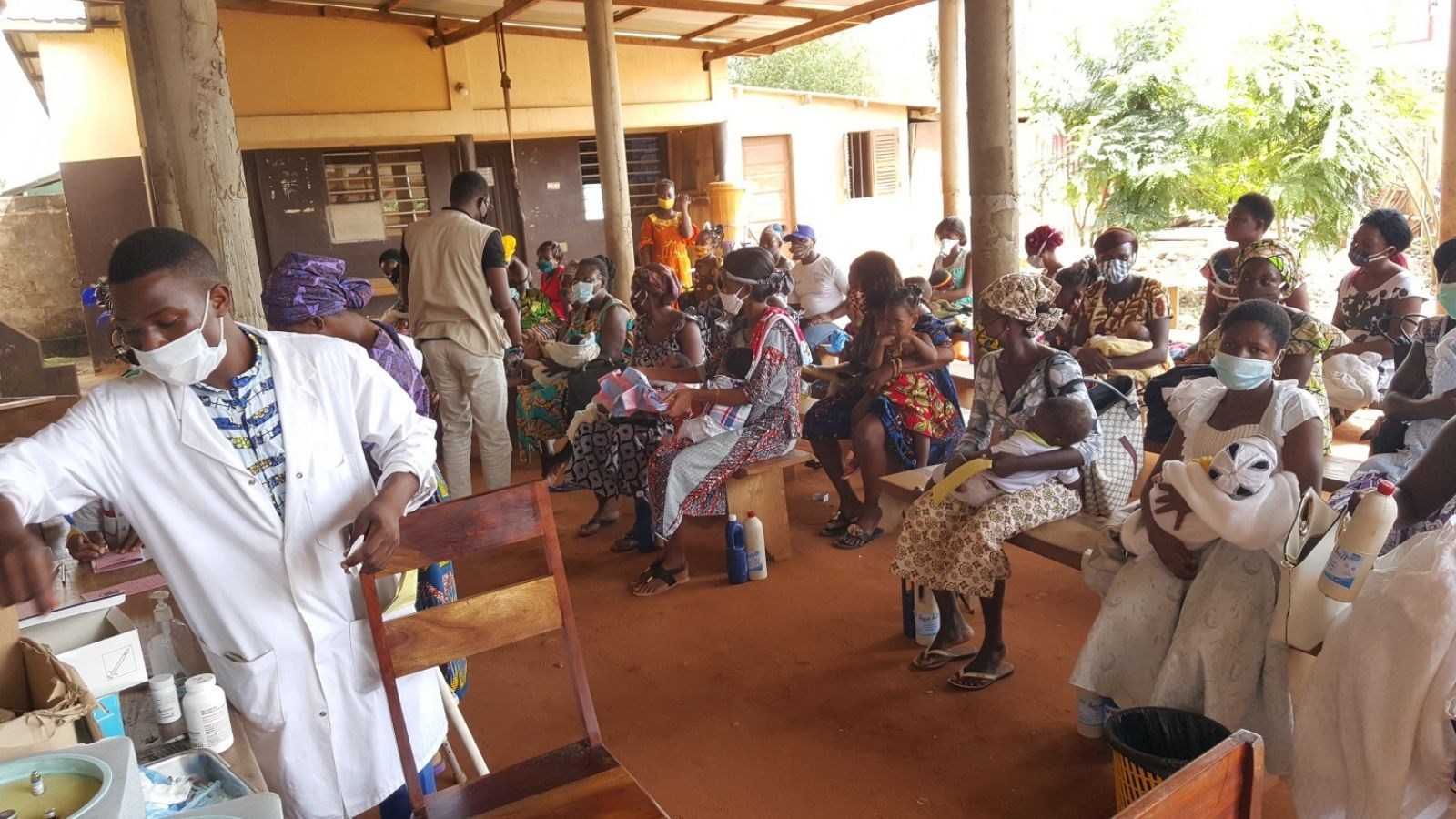 New mothers wearing masks receive health consultations and hygiene kits in Togo