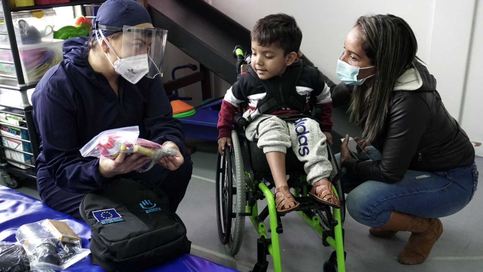 A young boy in a wheelchair continues to receive rehabilitation in Colombia during the pandemic.