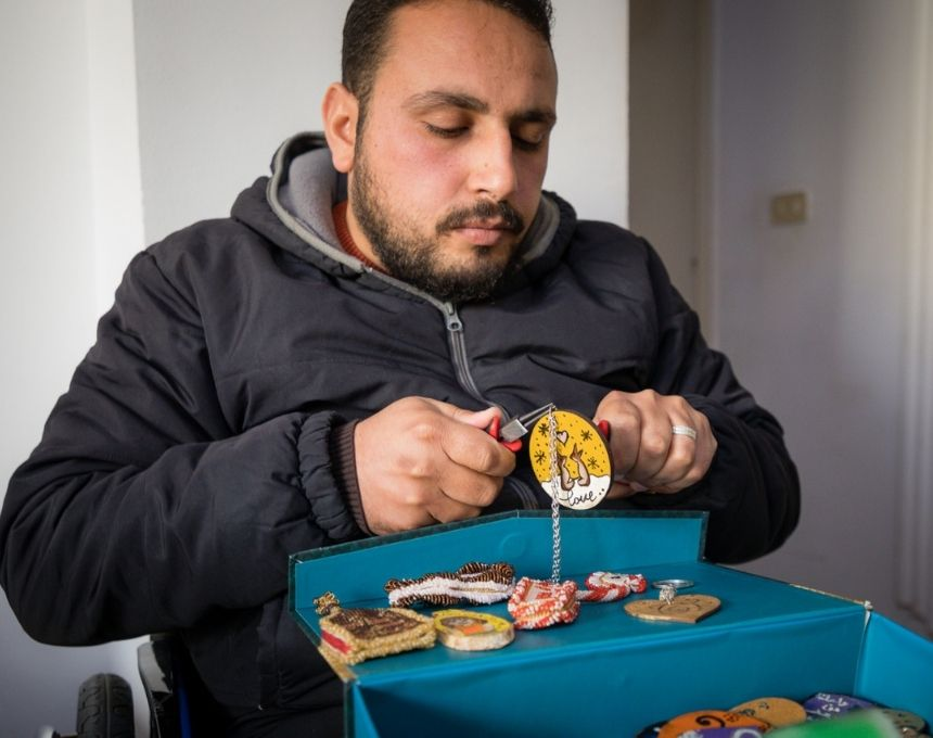 c_Said-Khlaifat_HI__A_man_named_Mohamad_crafts_while_sitting_in_his_wheelchair_at_his_home_in_Jordan.jpg