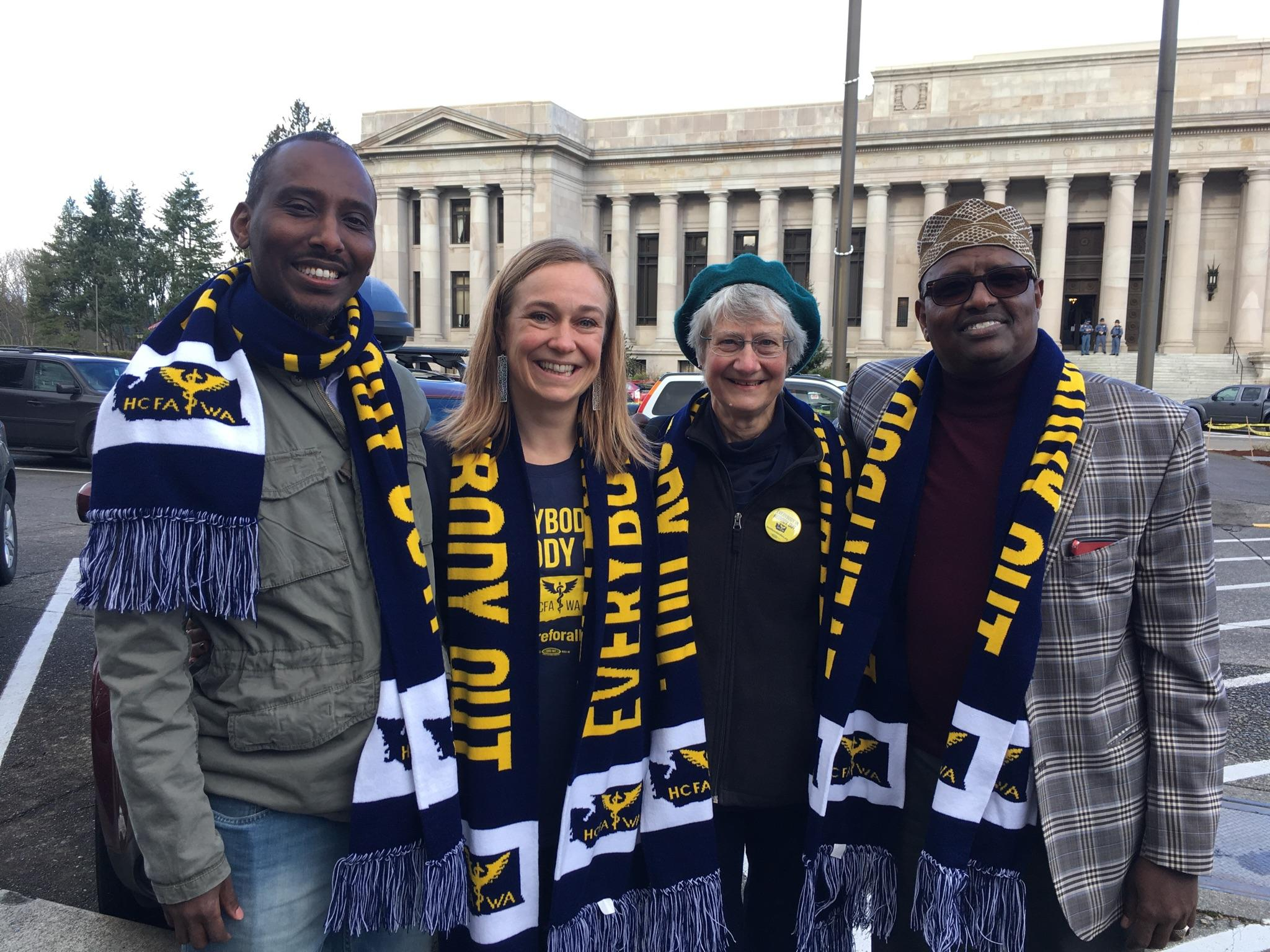 Ahmed Abdi, Program Director Bevin McLeod, HCFA-WA President Marcia Stedman, and Mohamed Sheik Hassan at our January Rally