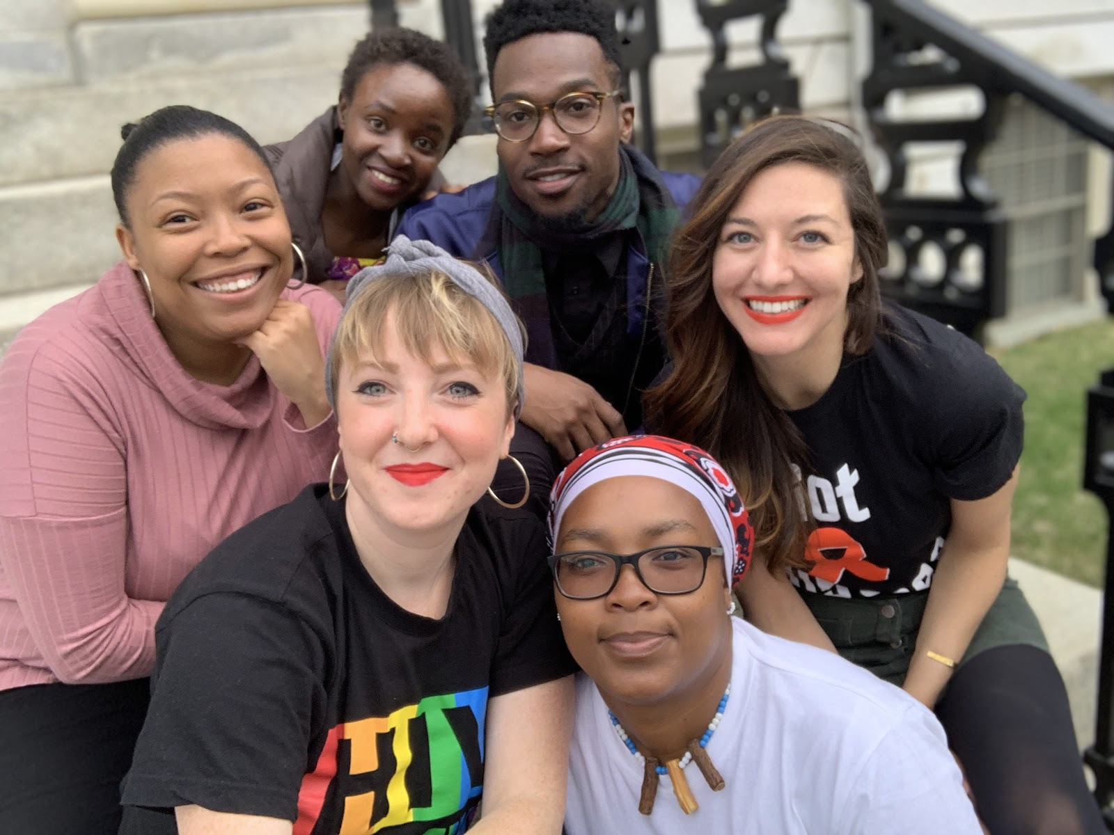 Members of the Speaker Tour sitting on the steps of Harvard Hall in Cambridge, Massachusetts (Back row, left to right: Becky Kroger, Resty Nalwanga, Gavyko Sumter; Front row, left to right: Emily Sanderson, Vovo Gonyela, Brittany Herrick)
