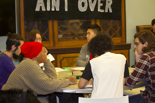SGACers in group discussion during a workshop at Fall Uprising