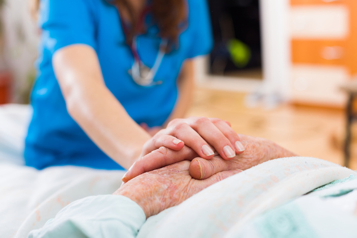 Elderly person receiving care from nurse