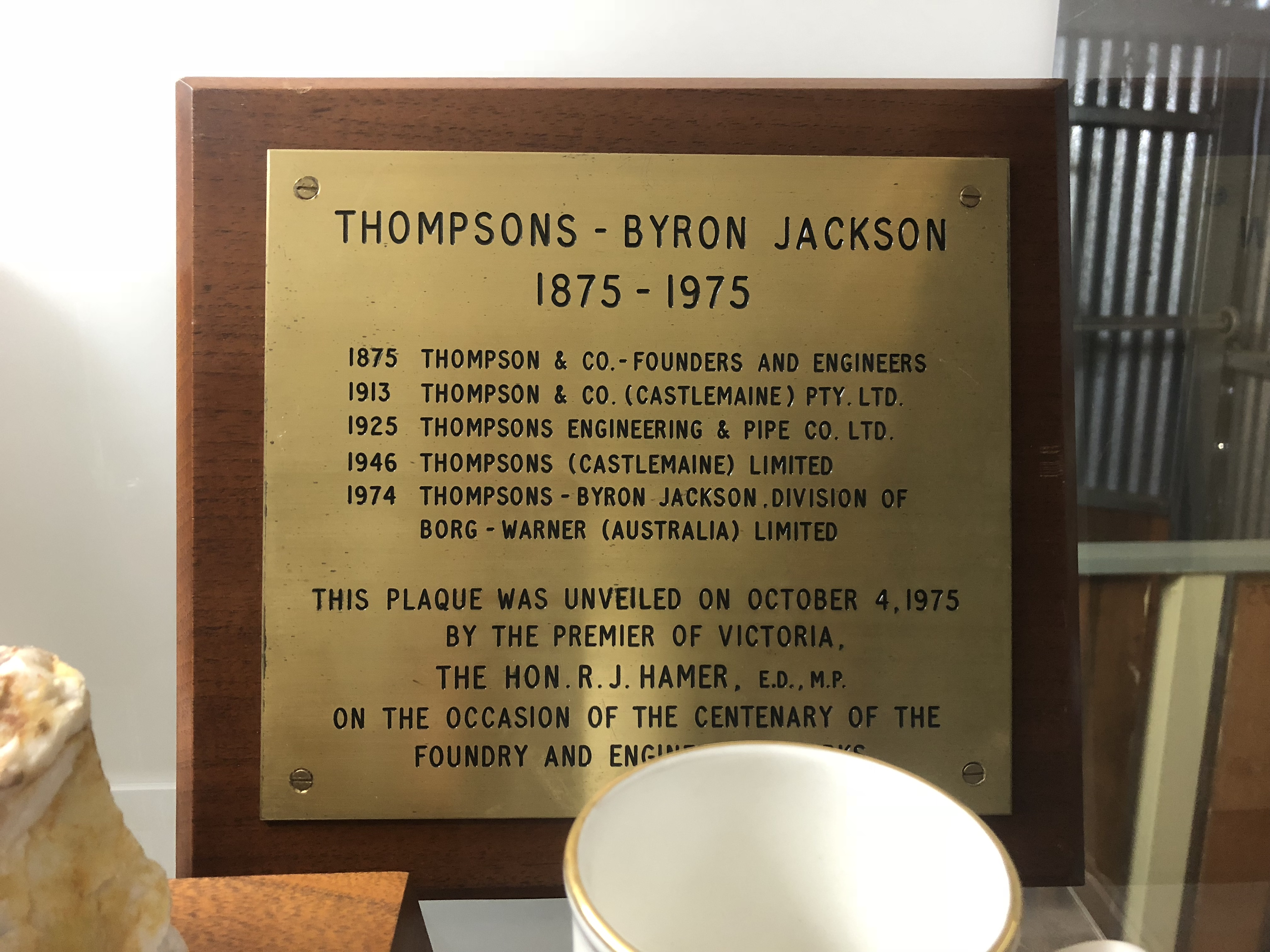 Plaque listing the evolution of Thompson's business