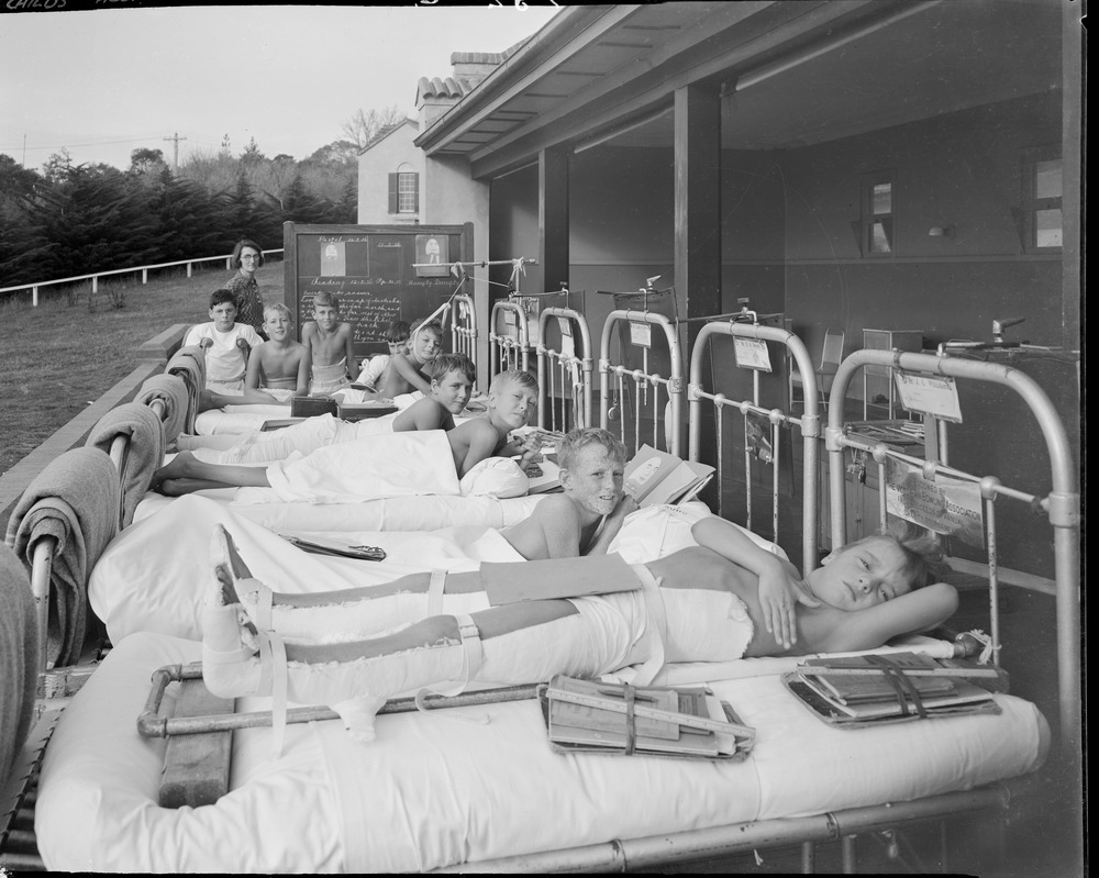 Children with polio having a school lesson on the sundeck of the Frankston Children's Hospital, Jackson's Road, Mt. Eliza