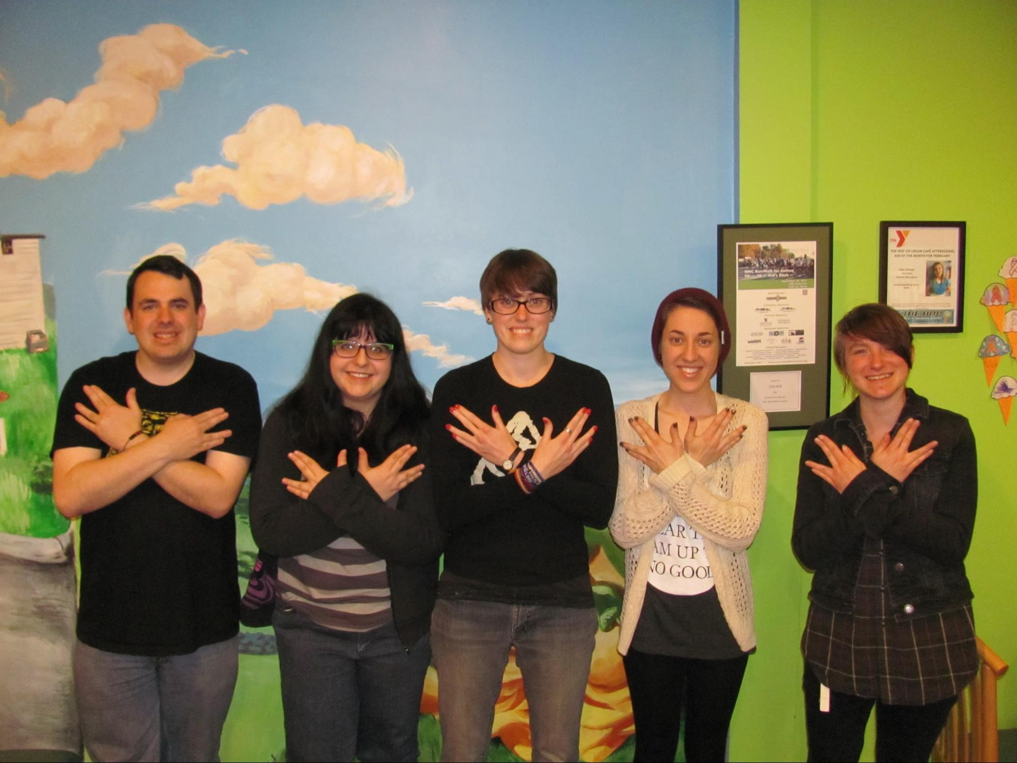 AHPA members doing Nerdfighter Sign