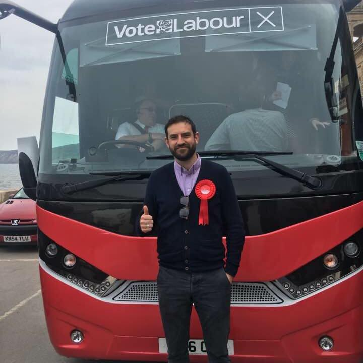 Hugo standing in front of campaign bus