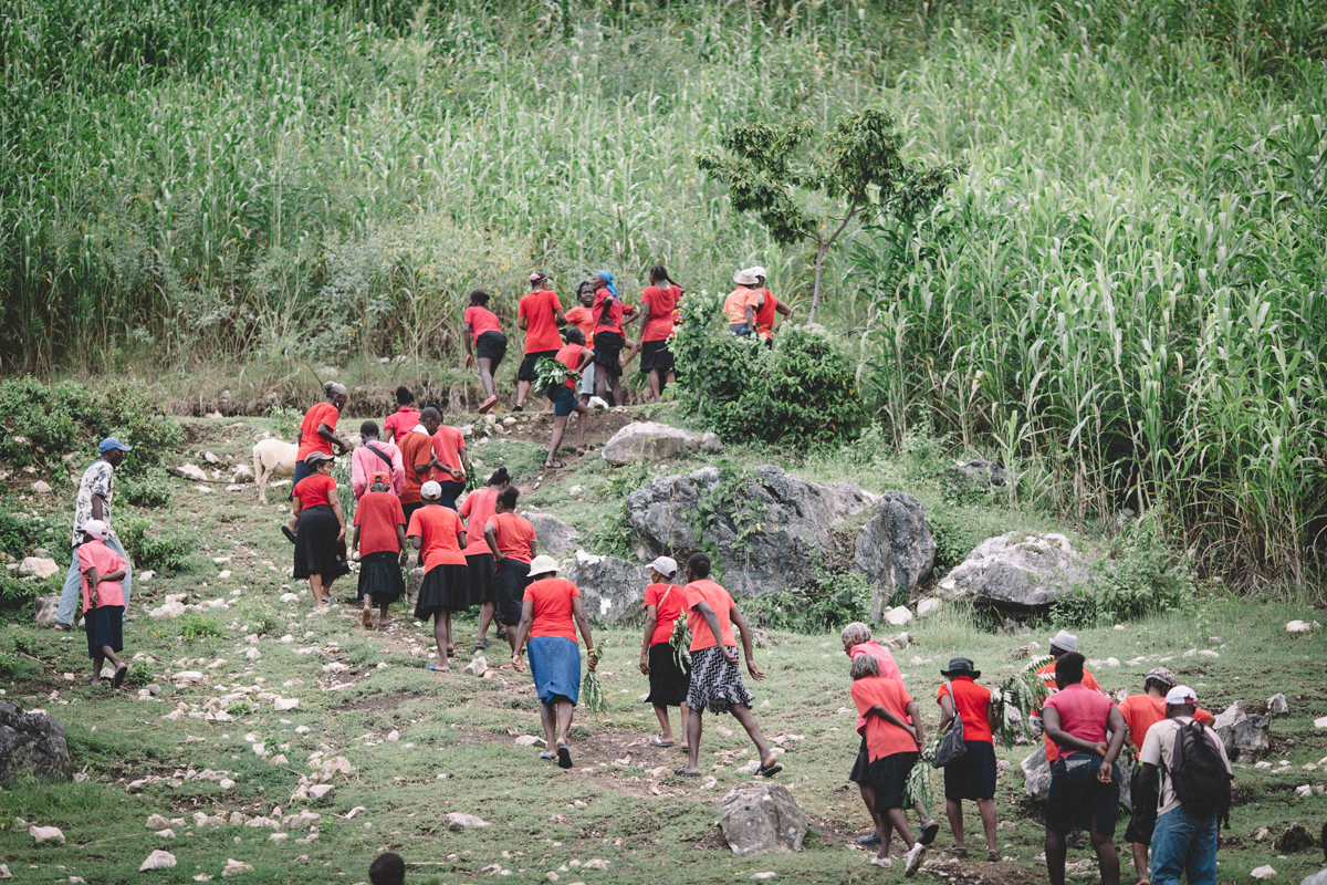 Women from the village's Adult Literacy Class lead the In a Perfect World group into their village.
