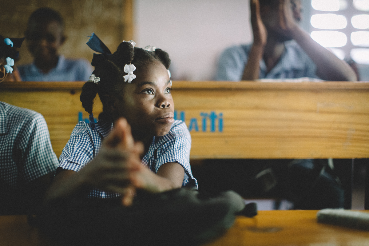 A student listens to her teacher during a lesson in a school built in partnership between buildOn and In a Perfect World.