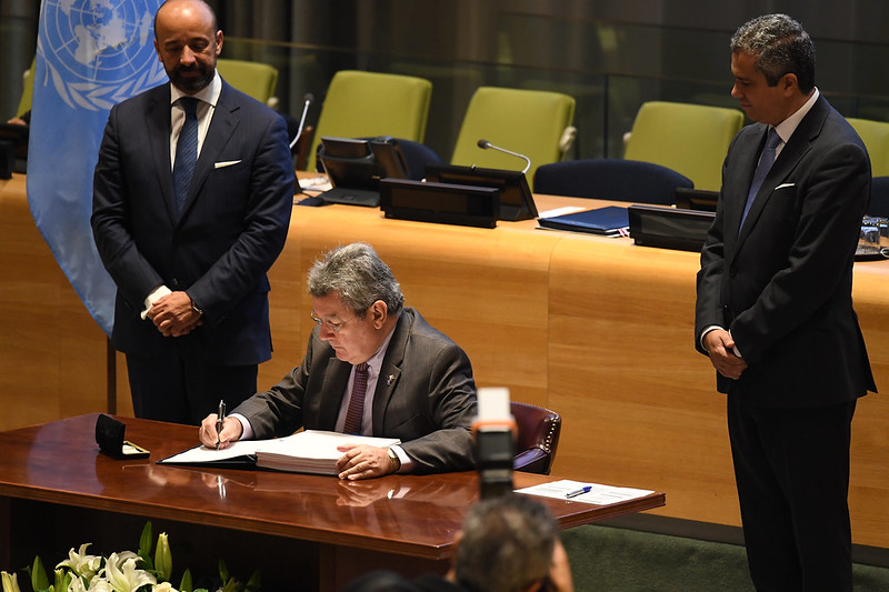 Mr. Elbio Rosselli, Permanent Representative of Uruguay signs the UN Treaty on the Prohibition of Nuclear Weapons