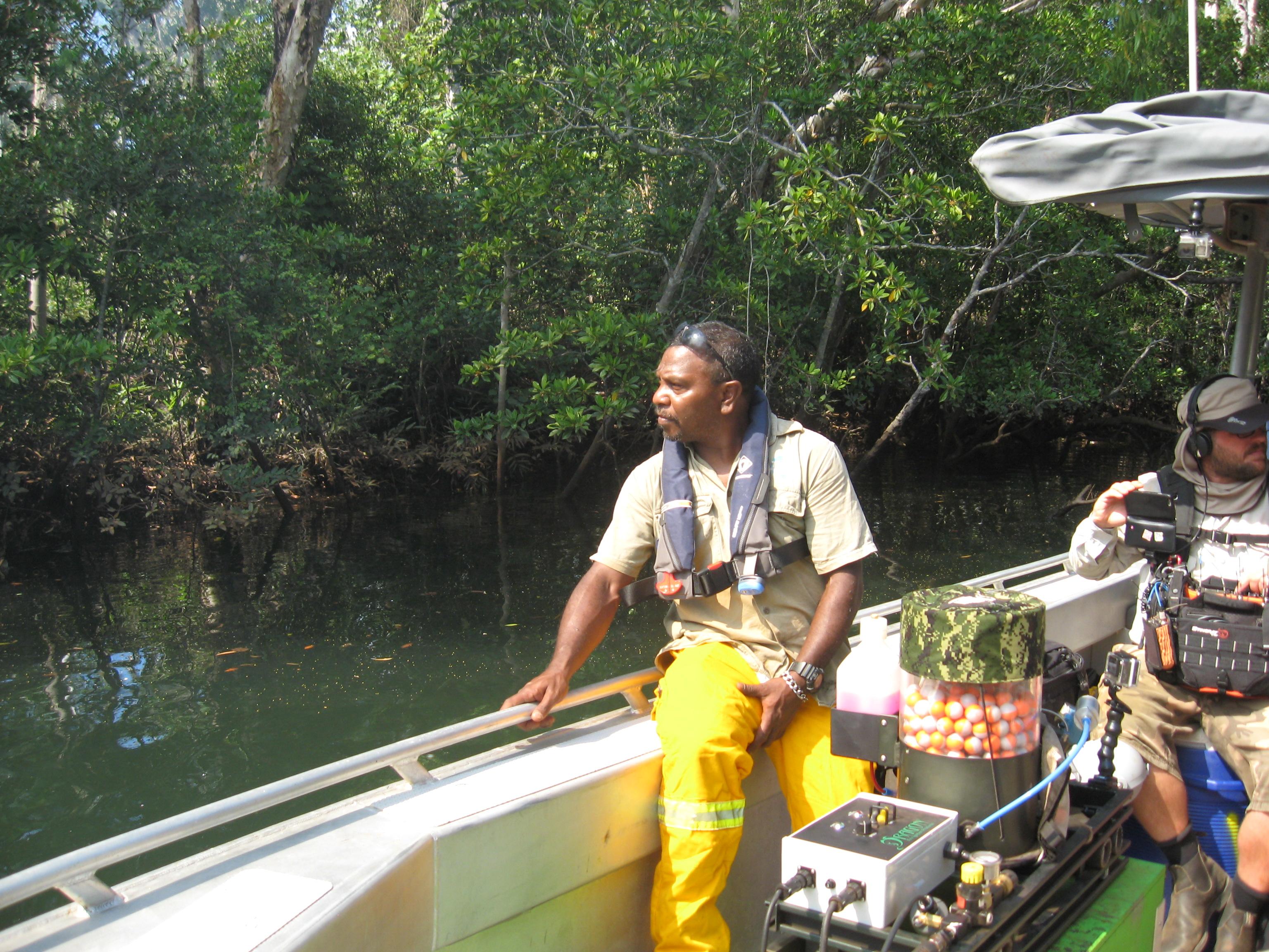 Senior Tiwi Islands Ranger Willie Rioli burning in the early dry season - via boat