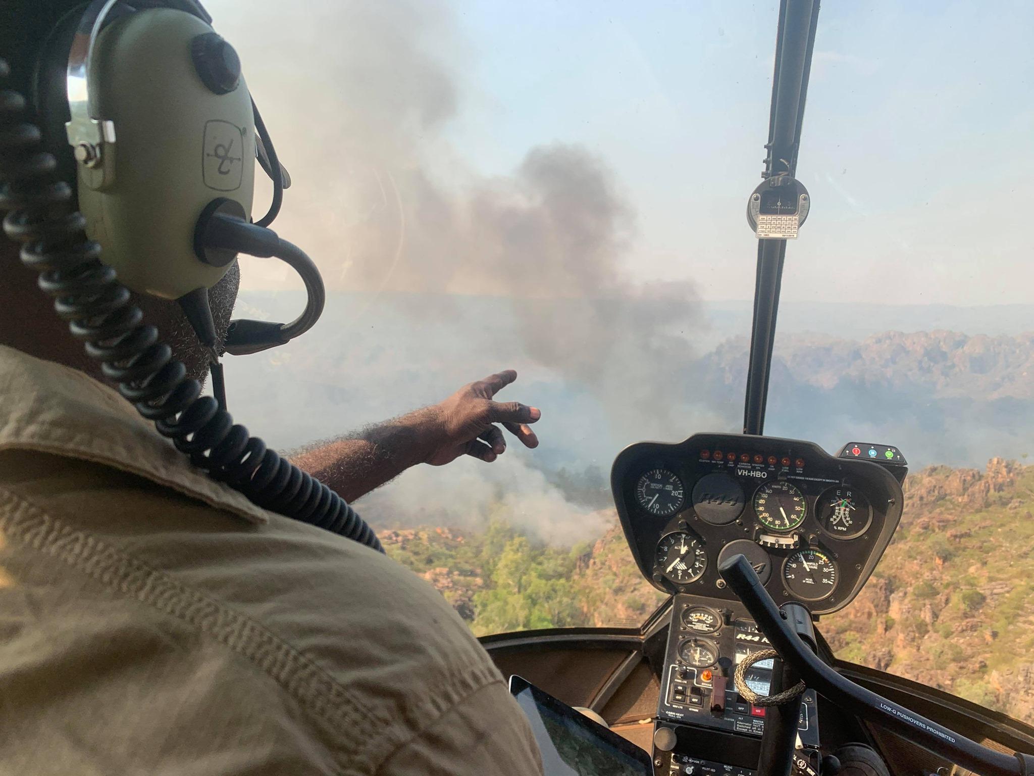Warddeken Senior Ranger Terrah Guymala aerial burning via helicopter in the early dry season 2020