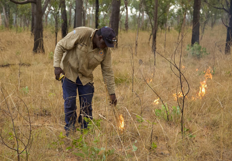 Jeremy Kowan lights a fire during Wunambal Gaambera's annual fire walk
