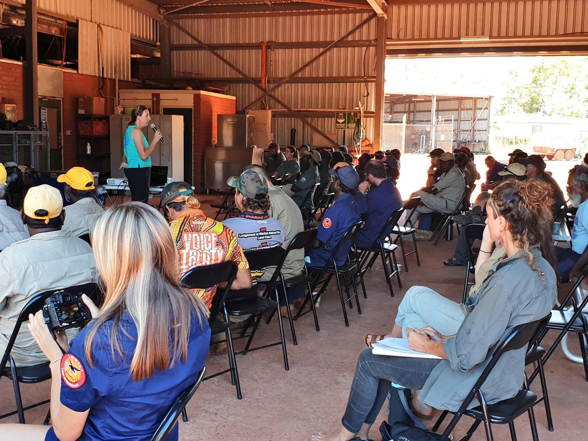 ICIN's Anna Boustead presenting at ALFA NT's Pre-Season Fire Meeting in Maningrida