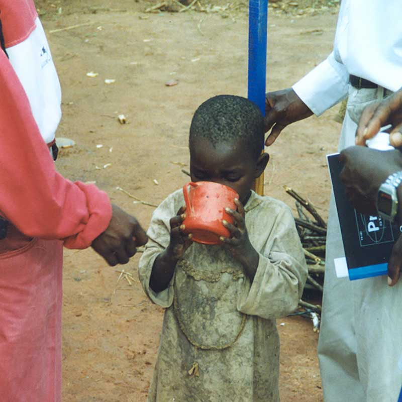 Young boy measured for dosage of Mectizan in Cameroon
