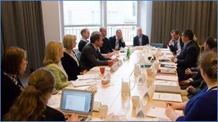 Sarah Myers sits at a round-table talk in Sweden about ImproveCareNow and the C3N Project