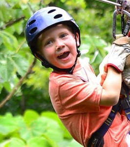 Parker going on a zip-line adventure before Crohn's diagnosis