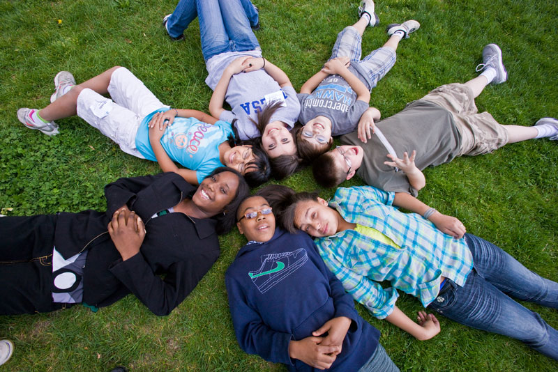 Kids in a circle on the grass