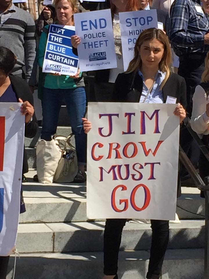 Jim_Crow_Must_Go.jpg