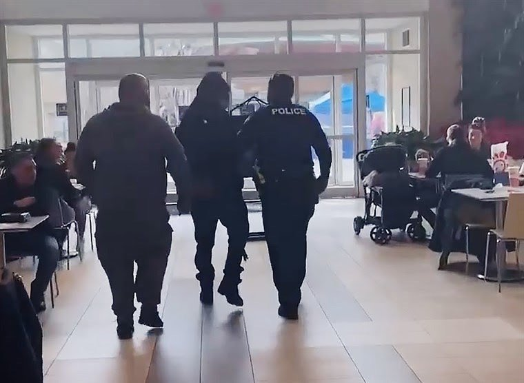 Police unjustly detaining Jamar Mackey. Lynnhaven Mall, Virginia Beach