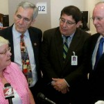 COPS / Metro Alliance leader Sr. Gabriela speaks to the press. Congressman Doggett and County Judge Wolff look on.