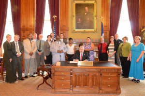 Photo of AMOS leaders at Governor's Signing of $100K for Project Iowa