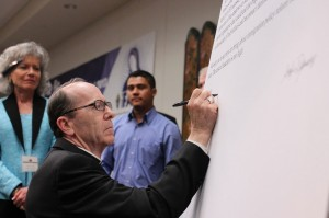 Catholic Bishop Olmsted signs letter to Congress for Immigration Reform at event organized by Valley Interfaith Project