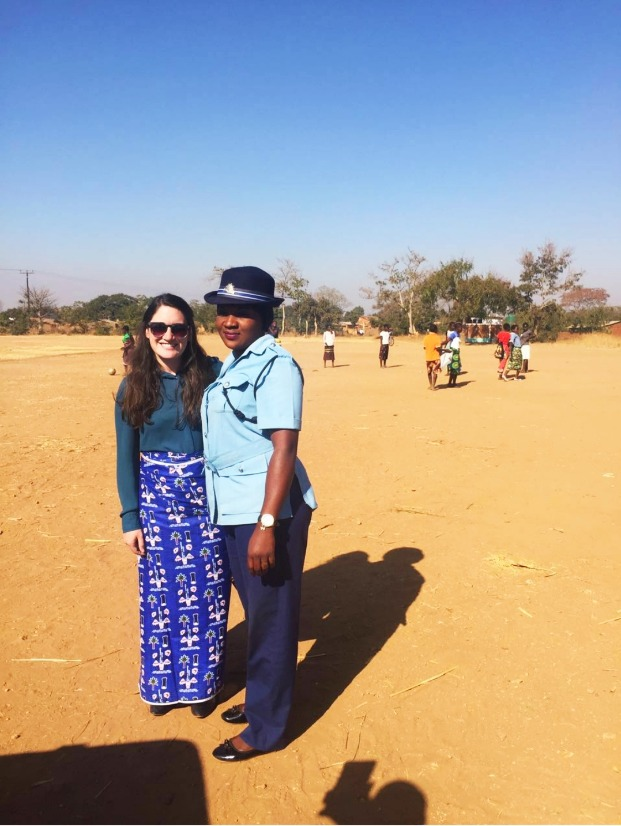 Sarah McGuckin at a legal aid clinic in a rural village in Malawi's Central region, with counterparts from the Malawian Police Service