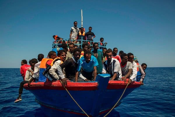 19Migrants1 articleLarge