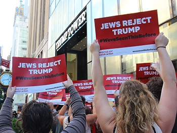 Bend the Arc Jewish Action volunteers protest outside Trump Tower in NYC.