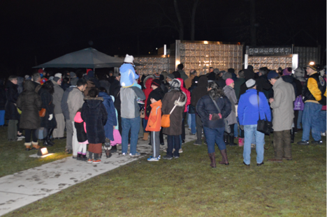 Over 100 people braved the cold weather to stand in solidarity with immigrants and refugees