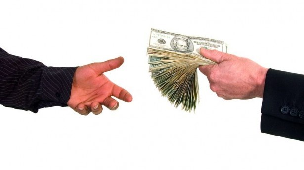 Business-man-handing-cash-to-another-person-loaning-money-via-Shutterstock-615x3451.jpeg