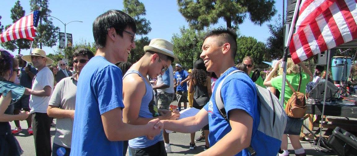 kenny_handshake_crop.jpg