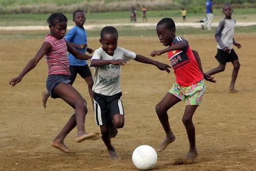 PlayingFootballLeoganeHaitiAllHands-2.jpg