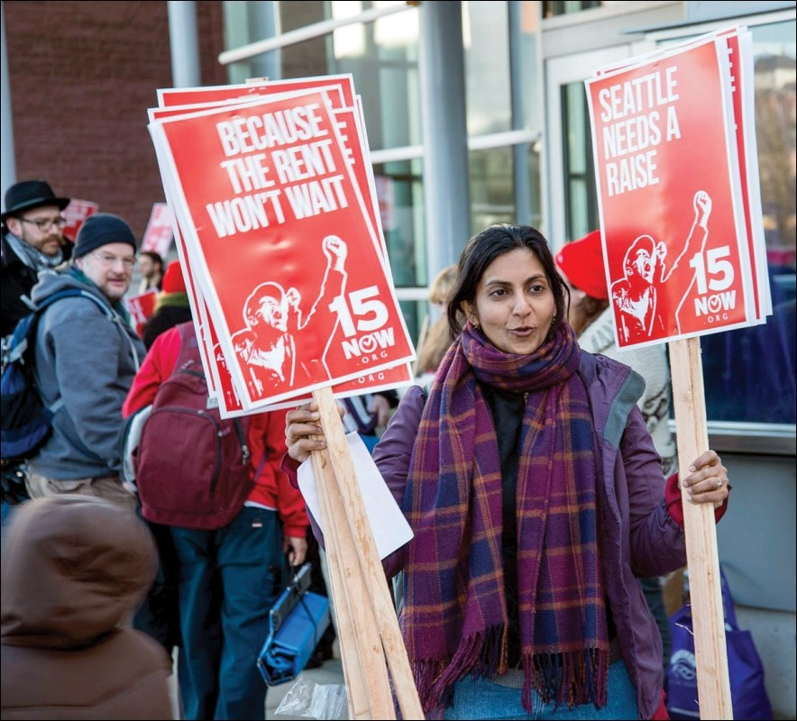 kshama_with_15_signs.jpg