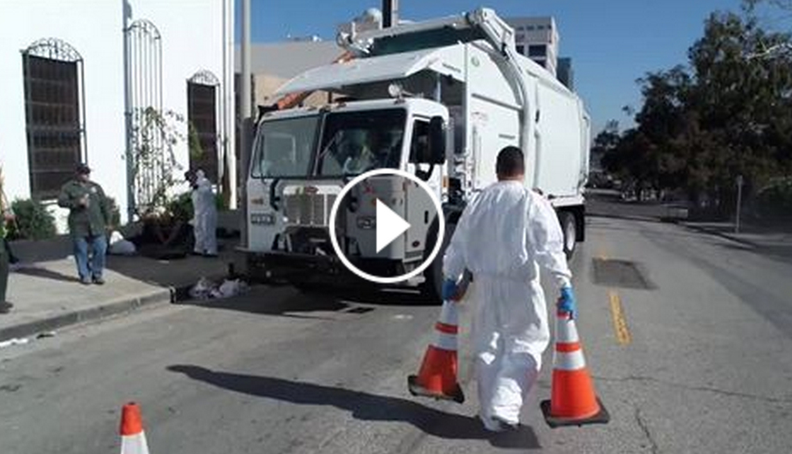 Link to video of encampment clean up with picture of trash truck