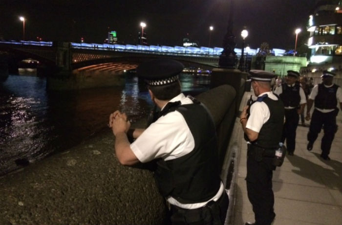 Officers looking for any sign of the man who walked into the Thames