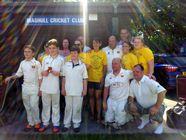 Zoë's Place volunteers and organiser Gill are pictured with Maghull Cricket Club players and MP Bill Esterson.