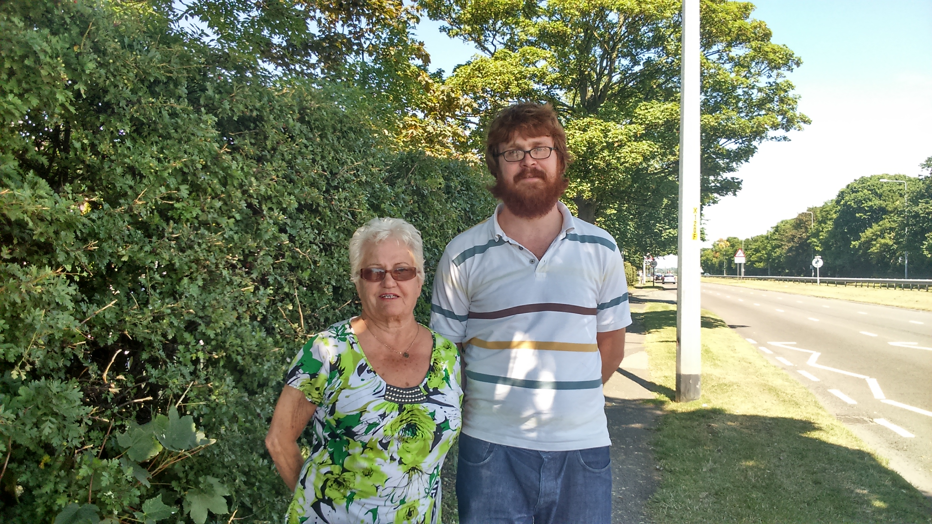 Maghull Labour councillor Rob Owens with resident Patricia Johnson and the newly cut back verges on Northway.
